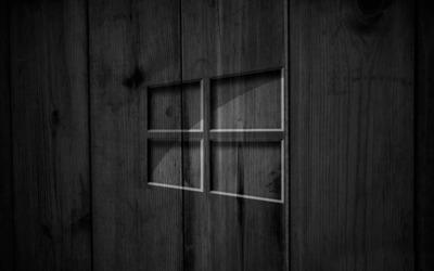 Windows 10 on black wooden panels wallpaper