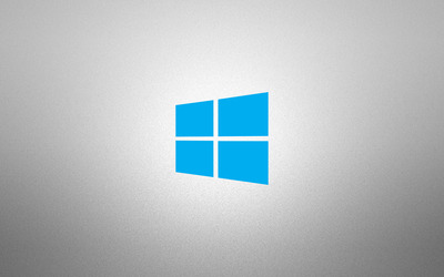 Windows 10 simple blue logo on grainy gray wallpaper