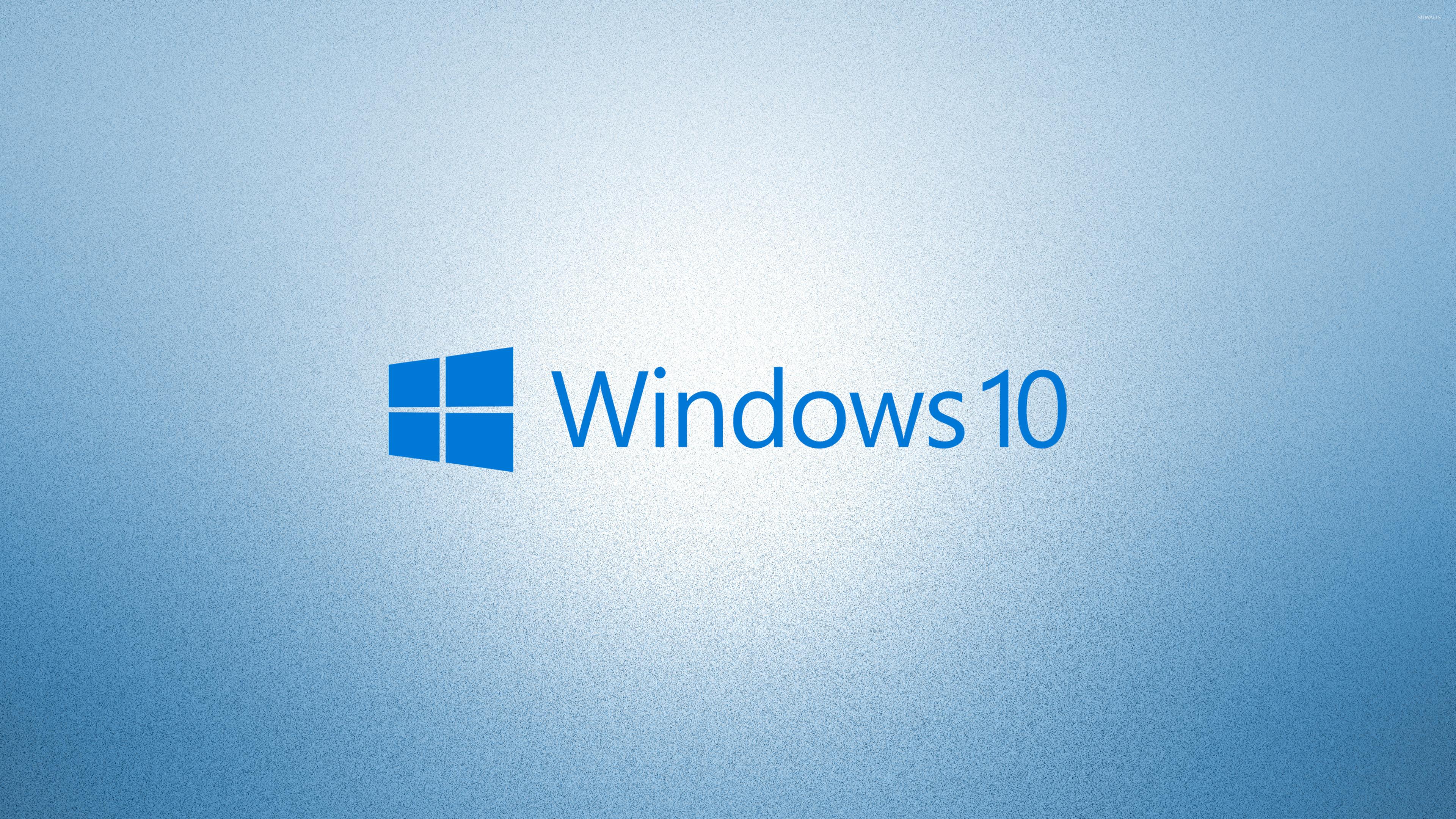 windows 10 blue text logoon light blue wallpaper