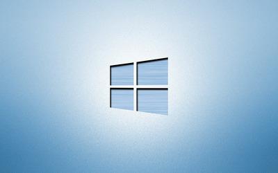 Windows 10 blue polished metal logo on light blue wallpaper