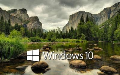Windows 10 on the mountain lake white text logo wallpaper