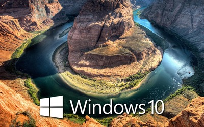 Windows 10 over the canyon white text logo wallpaper