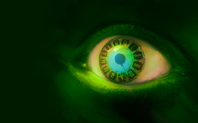 Clock in a green eye wallpaper