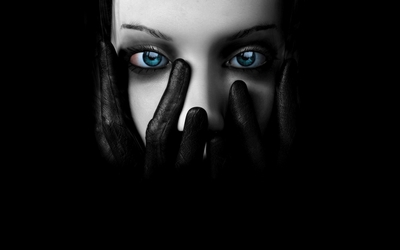 Girl with black leather gloves with hands on her face wallpaper