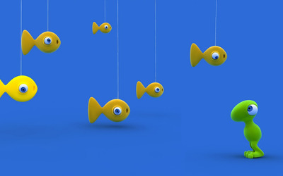 Hanging fish against little alien wallpaper