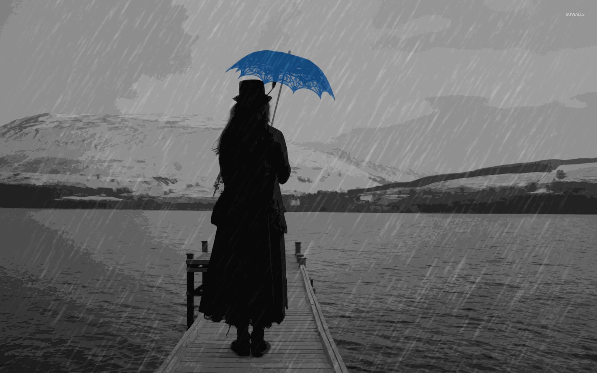 Lady In Black Under A Blue Umbrella Wallpaper