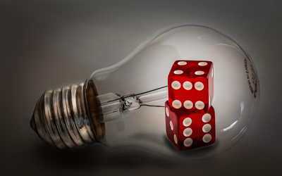 Red dice inside the light bulb wallpaper