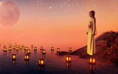 Sad woman watching the candles floating on the water wallpaper