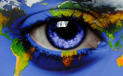 World map around an eye wallpaper