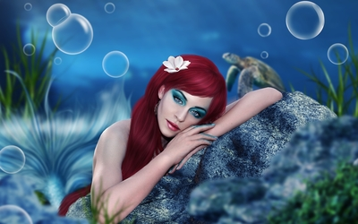 Beautiful redhead mermaid resting on a rock wallpaper