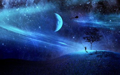 Boy with his kite in a blue night wallpaper