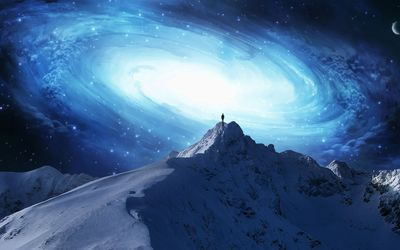 Man on the mountain peak overlooking the galaxy wallpaper