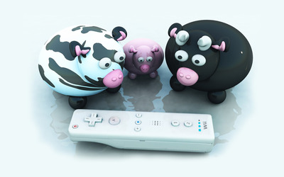 Cows looking at a Wii controller wallpaper