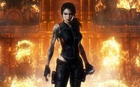 Lara Croft exiting a burning building - Tomb Raider wallpaper 1920x1200 jpg
