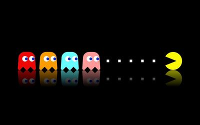 Pac-Man chasing the ghosts wallpaper