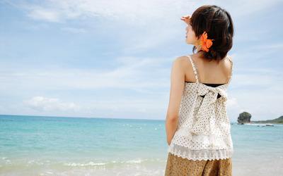 Asian girl at the beach wallpaper