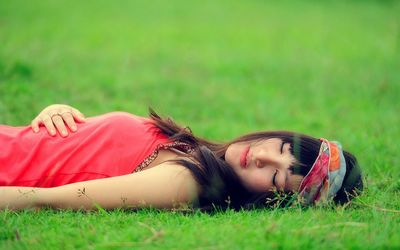 Asian girl in the grass wallpaper