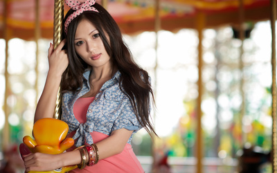 Asian girl on a carousel wallpaper