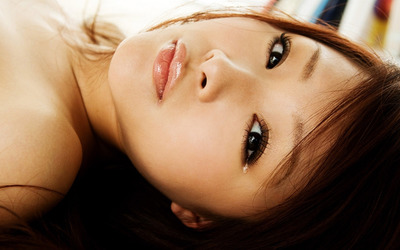 Asian girl with a tear drop in her eye wallpaper