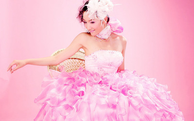 Asian lady in a pink dress wallpaper
