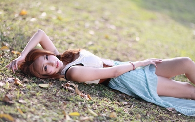 Asian redhead in a pale blue dress wallpaper