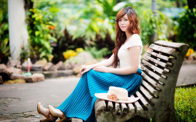 Asian redhead on a bench wallpaper