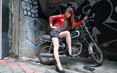 Asian redhead on a motorcycle wallpaper