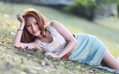 Beautiful asian redhead on the ground wallpaper
