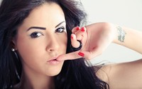 Beautiful brunette with a finger between her lips wallpaper 2880x1800 jpg