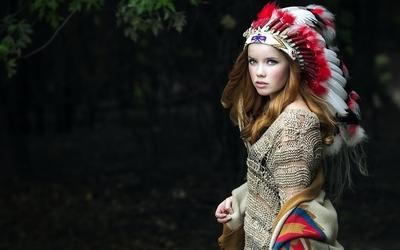 Beautiful girl in a native american costume wallpaper