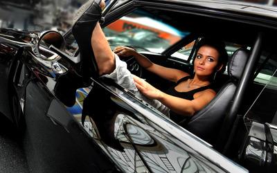 Beautiful girl in her car wallpaper