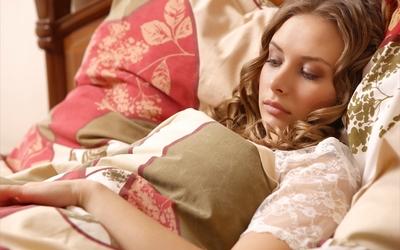 Beauty resting in bed wallpaper