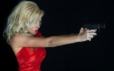 Blonde beauty with a pistol wallpaper