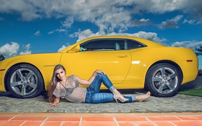 Blonde girl by a yellow Chevrolet Camaro wallpaper