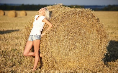 Blonde girl on a hay bale wallpaper