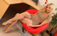 Blonde girl on an orange chair wallpaper 2880x1800 jpg