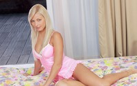 Blonde in pink on the bed wallpaper 2560x1600 jpg