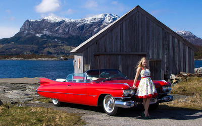 Blonde with an old car by the lake wallpaper