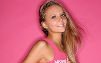 Blue eyed blonde in front on a pink wall wallpaper 2560x1600 jpg