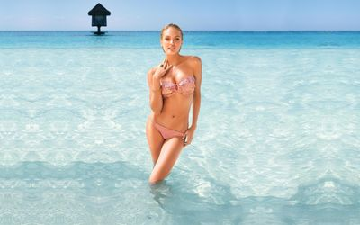 Candice Swanepoel in the clear ocean water wallpaper