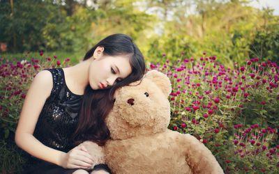 Cute asian girl with a teddy bear wallpaper