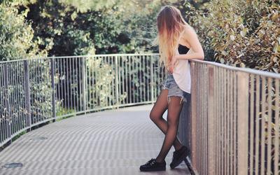 Girl waiting on a bridge wallpaper