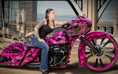 Jody Perewitz on a pink custom made motorcycle Wallpaper