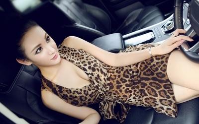 Joyce Yuexi Li in a car wallpaper