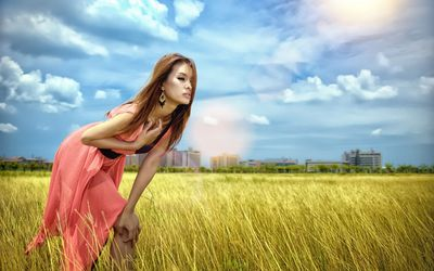 Model in a pink dress on a field wallpaper