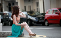 Model sitting on the sidewalk wallpaper 2560x1600 jpg