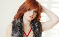 Redhead in a furry vest with a hand on her head wallpaper 1920x1080 jpg