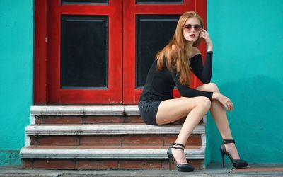 Redhead in shorts on the stairs wallpaper