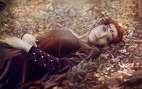 Redhead lying on autumn leaves wallpaper 1920x1200 jpg