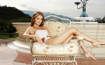 Redhead on an armchair wallpaper